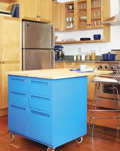 Two Cabinet Island using old metal file cabinets. Add casters, paint, butcher block top.