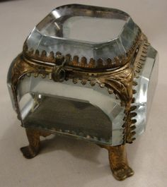 From Paris, circa 1920. Pretty little box for a single special jewel or tiny tokens. $750  All original beveled glass, original tufted interior.