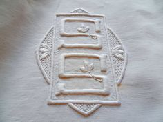 Dramatic Monogram SS on a linen & cotton metis sheet sold by chatelaine-chic.