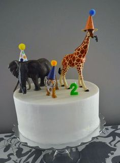 When it comes to decorating a two year olds birthday party you can go tacky or just right. Check out our animal birthday party details.
