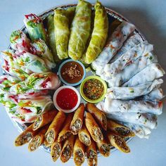 The ultimate platter of rolls. There's steamed rolls, cabbage rolls, eggrolls, and spring rolls. Three dipping sauce....sweet chilli sauce with crushed peanuts, peppery garlic sauce and peanut sauce. Hmong style food. My kind of rolls