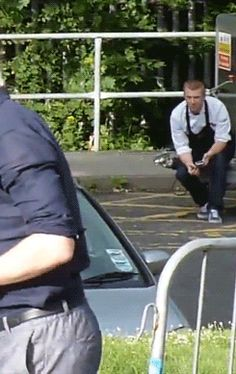 ~~Hey you! Yeah, you, creepy, stalkerish dude in the white shirt & black apron! Tom might not have noticed you, but I sure did! ~ #TomHiddleston on the Bangor set of #HighRise~~