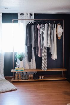 DIY Garment Rack for Your Wardrobe Rolling DIY Garment Rack. Get the full simple and easy tutorial to make your own wardrobe rack! Get the full simple and easy tutorial to make your own wardrobe rack!