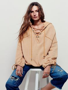Winston Hoodie | Worn-in and washed pullover hoodie featuring lace-up detailing at the neckline. Super comfy oversized fit with dolman sleeves. High low hem and adjustable tie detailing at the cuffs.