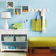 Combine wall cubbies, a small bookcase, and an ottoman to create a similar entryway! More storage solutions: http://www.bhg.com/blogs/better-homes-and-gardens-style-blog/month-of-storage/