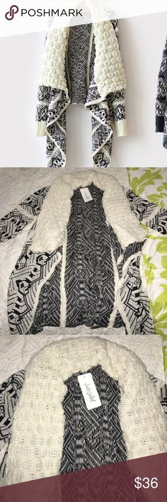 Jade & Juliet Longline Cardigan Open Cardigan. Long, hanging sides. Long sleeve! 85% Polyester, 15% Acrylic. Dry Clean ONLY. Size- M/L Jade & Juliet Sweaters Cardigans