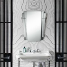 Such a clean and simple design that's made by the art deco mirror and art deco basin. We <3 it all!