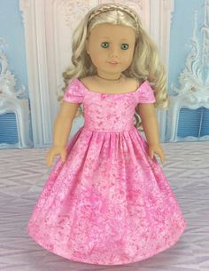This 18 inch ball gown doll dress is made to fit american girl and similar sized dolls. This stunning off the shoulder ball gown style dress is made from Pink designer fabric that has touches of Silver shine all over it. I finished the gown with a lined bodice and rolled hem. These techniques do take more time, but they add a professional look to the garment and add to the durability. Gown closes in back with snag free velcro.  My doll and her shoes are not included. Please ask any…