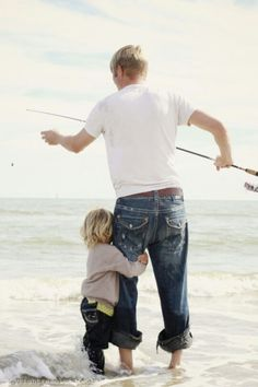 Daddy daughter surf fishing