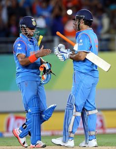 Suresh Raina and MS Dhoni shared an unbroken 196-run stand to lift India to a six-wicket win, India v Zimbabwe, World Cup 2015, Group B, Auckland, March 14, 2015 ©AFP | www.indiadefends.com #IndiaDefends
