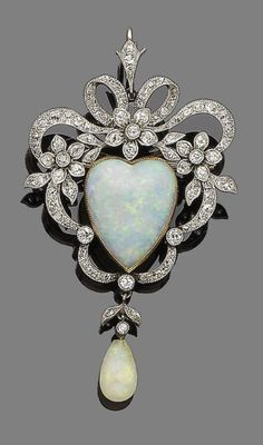 An opal and diamond brooch/pendant, circa 1890.  The openwork cartouche of ribbon and floral design, set throughout with cushion-shaped, old brilliant and single-cut diamonds, and to the centre with a heart-shaped cabochon opal, suspending an opal drop, diamonds approx. 1.20cts total, later detachable brooch fitting,