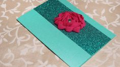 Turquoise matte card with red-pink flower on shimmery turquoise band