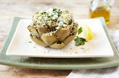 There is truly nothing like an artichoke oozing with cheese, seasoned with fresh herbs and finished with a crunchy bite, thanks to Italian bread crumbs.