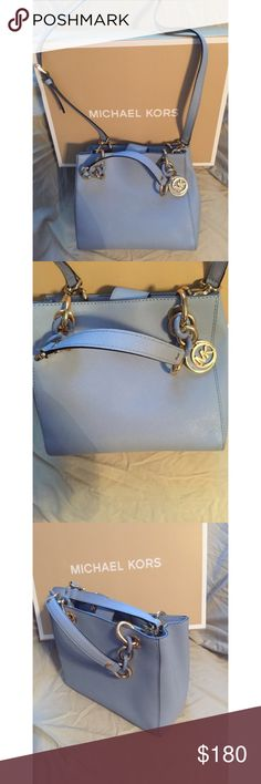NWOT Michael Kors Blue Cynthia Small Saffiano Bag NWOT!! Comes with gift box. Dust bag included. Four interior pockets. One zipper in the middle. And a clasp to hold keys inside. Can be held as shoulder bag, satchel or Crossbody. Michael Kors Bags