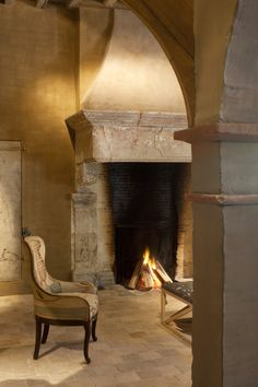 Modern tech w/ old materials in fireplace by Joris Van Apers