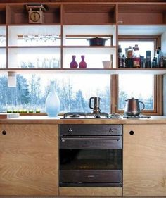 Aas Thaulow plywood kitchen cabinets with cutouts, Norway   Remodelista