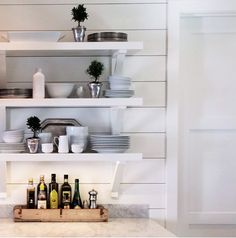 love the open shelving with white accessories