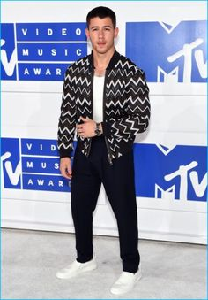 Nick Jonas makes a chic statement in an ensemble from Louis Vuitton for the 2016 MTV Video Music Awards.
