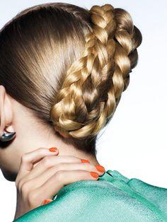 Rising runway star Ondria Hardin wears a super-chic braided updo.