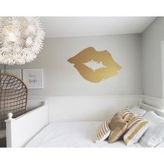 Beautiful bedroom set up in house with our big gold lips.
