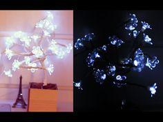 Materiais usados e preços: - Fita isolante | R$ 1,99 - Flores | R$ 2,99 - Vaso | R$ 3,90 - Luz de natal com flores | R$ 34,00 Obs.: Você pode comprar luz de ...