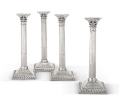 A set of four George III silver candlesticks, Ebenezer Coker, London, 1762 formed as Corinthian columns with openwork capitals, on stepped and gadroon bases, matching crested nozzles, weighted bases marked on base rims and nozzles, tops numbered 1-4 and with scratch weights 21=1 1/2, 21=8, 22=3 1/2, and 21=12 height 12 1/2 in. 31.7 cm