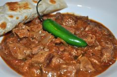 Carne Guisada - You can serve this with rice, or beans or make some great tacos! I love breakfast tacos made with some carne guisada, scrambled egg and cheese! Carne Guisada is a Mexican inspired take on beef stew. Authentic Mexican Recipes, Mexican Food Recipes, Kitchen Boss, Tex Mex Essen, Good Food, Yummy Food, Soft Tacos, Mexican Cooking, Vegetarian Mexican