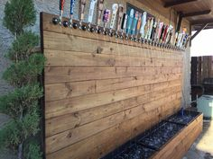 Water fountain of taps w craft beer handles. Could make back wall custom shape (state outline, hop cone, etc) too.