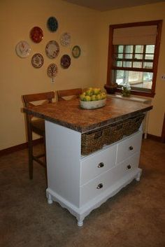 Dresser/changing table turned kitchen island....I would add posts under the bar for stability though