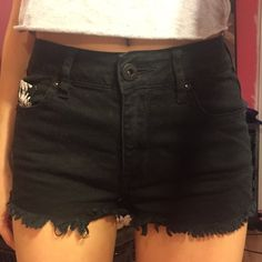 Semi High Waisted Black Shorts With Daisy Pockets They're a size 0, in fantastic condition. They're a little too short for my liking (which is why I'm looking to sell them). Bullhead Shorts Jean Shorts