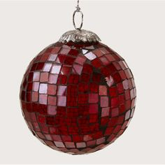 Handmade mosaic glass ball has a silver ribbon for hanging. Made in India