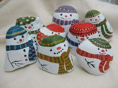Snowmen painted on stones