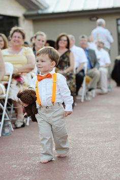 Ring bearer with wedding color suspenders and bow tie. Oh gosh, how adorable is this.