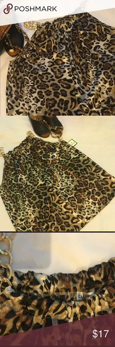 NWT Leopard Halter Top NWT polyester leopard patterned sleekness shell with gold chain accent shoulders. Very silky feel machine washable Really cute with white or black slacks. Great party or social piece kaelyn -Max Tops Black Slacks, Leopard Pattern, Shell, Chain, Party, Gold, Closet, Things To Sell, Women