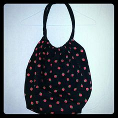 Black Strawberry Patterned Purse Tote Bag This is a really cute purse. It is black with strawberries all over it. It has rounded straps and is a large size back. Perfect for everything you need to carry! #purse #strawberry Bags Hobos
