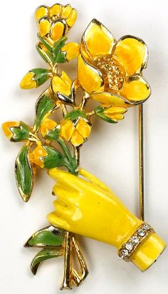Coro Gold and Enamel Hand Holding a Yellow Passion Flower Spray Pin