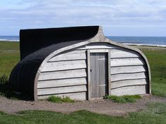 Use a wooden boat hull to build a small cabin!