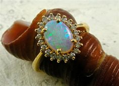 Vintage Australian Opal and Diamond Halo Ring October Birthstone - 20% will be Donated to The Red Cross for Hurricane Sandy Victims. $600.00, via Etsy.