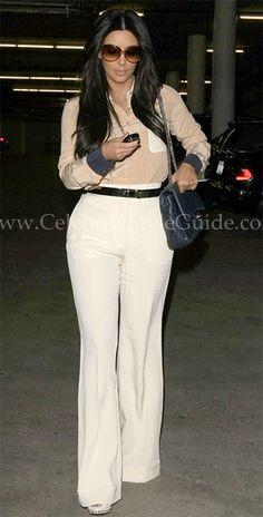 Kim Kardashian looked sophisticated and chic wearing See by Chloe Color Block Button Down Blouse and Rachel Zoe Hutton Bootcut Pants out in Santa Monica, California January 18, 2012