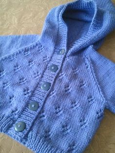 This is a bottom up hooded cardigan. The body is knit in the openwork diamond stitch pattern in one piece. The full length sleeves are knit in Stockinette from the remaining body stitches in the round. The hood stitches are knit up from the collar and knit in two pieces. The hood is knit in stockinette and then grafted together. The button band is then picked up and knit for 5-8 buttons depending on the size.