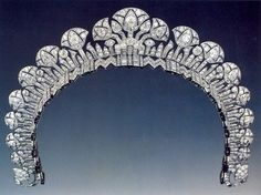 ART DECO TIARA OF THE BEGUM AGA KHAN, YVETTE LARBOUSSE 1934. This beautiful Cartier tiara is in the neo-Egyptian style with stylized lotus flowers, set onto a diamond band and worn higher on the head. This tiara was featured in the Cartier Exhibition held in Paris 2013-2014, and is part of the collection of jewels held in the Alexandria Royal Jewelry Museum Collection in Alexandria, Egypt.
