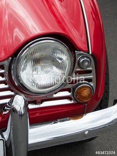 Roter englischer Triumph TR 4 Roadster der Sechzigerjahre mit viel Chrom im Oldtimer-Park Lippe in Lage bei Detmold in Ostwestfalen-Lippe