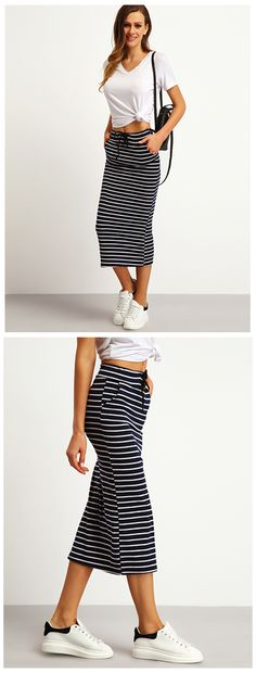 Looking for the perfect balance between sporty and chic? The Stripe Fitted Midi Skirt will be your favorite this season! Features a tie waist, pockets, and a classic pinstripe pattern.