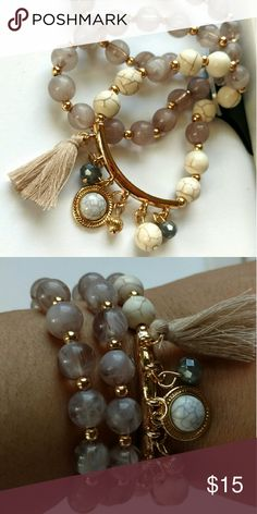 Bracelet trio Acrylic marbleized bead stretch bracelets with a howlite charm bracelet featuring grey faceted glass beads and a tan nylon tassel charm. Boutique Jewelry Bracelets
