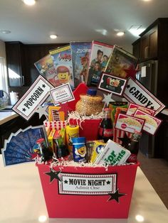 A Comprehensive List Of Beautiful Christmas Gift Baskets For Everyone On Your Li. - A Comprehensive List Of Beautiful Christmas Gift Baskets For Everyone On Your Li. Movie Basket Gift, Movie Night Gift Basket, Movie Gift, Date Night Basket, Gift Card Basket, Theme Baskets, Themed Gift Baskets, Raffle Baskets, Fundraiser Baskets