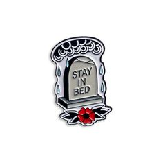 Stay In Bed. There's nothing out there for you. - Soft Enamel Gravestone Stay in Bed pin. - 1 inch in diameter - Rubber stop backing - Comes with Daisy and Aster card backing