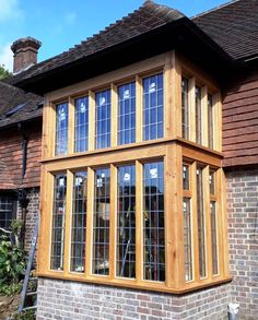 Two storey Oak bay window with leaded glass Timber Windows, Bay Windows, Leaded Glass, Surrey, Joinery, Mansions, House Styles, Home Decor, Carving