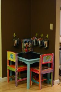 chalkboard table! and pails on the wall for storage