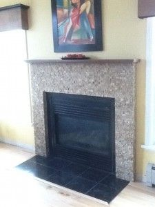 This is a fantastic tile to do this fireplace project with. An open split face tile from Dal Tile that uses no grout to showcase the natural beauty of this stone.