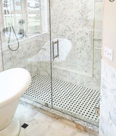 "Tile Shower Ideas. Marble bathroom ideas.  Herringbone mosaic marble. Tilebuys.com (@tilebuys) on Instagram: ""Calacatta Gold Marble Bathroom. Amazing master bathroom remodel in my home town of Sioux Falls."" #bathroomdesign #bathroomremodeling #bathroomrenovations #homedecor #masterbathrooms #marblebathroom #tiles #homeimprovement #interiordesign #decor #herringbone #marblefloor #showertile #whitemarble #remodelingideas #renovations #bathroomdecorideas #tiledesign #tileideas…"